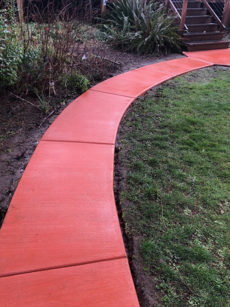 Red curved concrete walkway