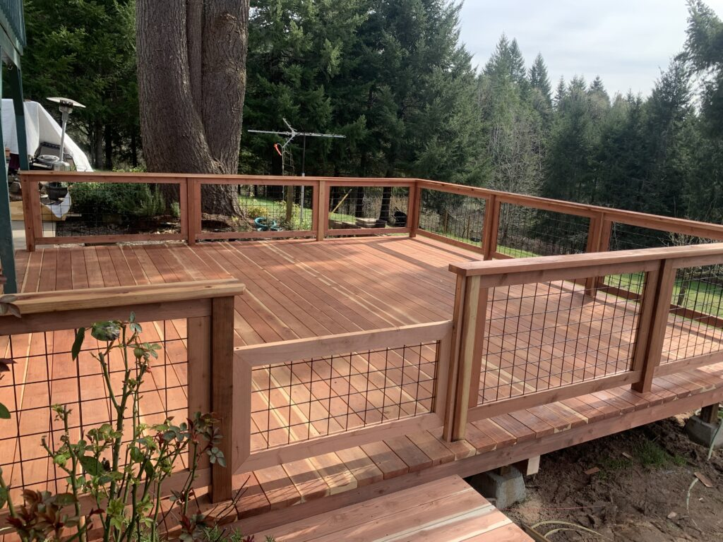 Square wooden deck with fencing