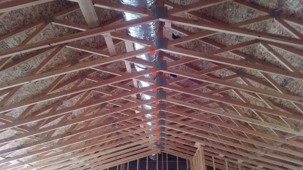 Inside framing of a house's roof and infrastructure support