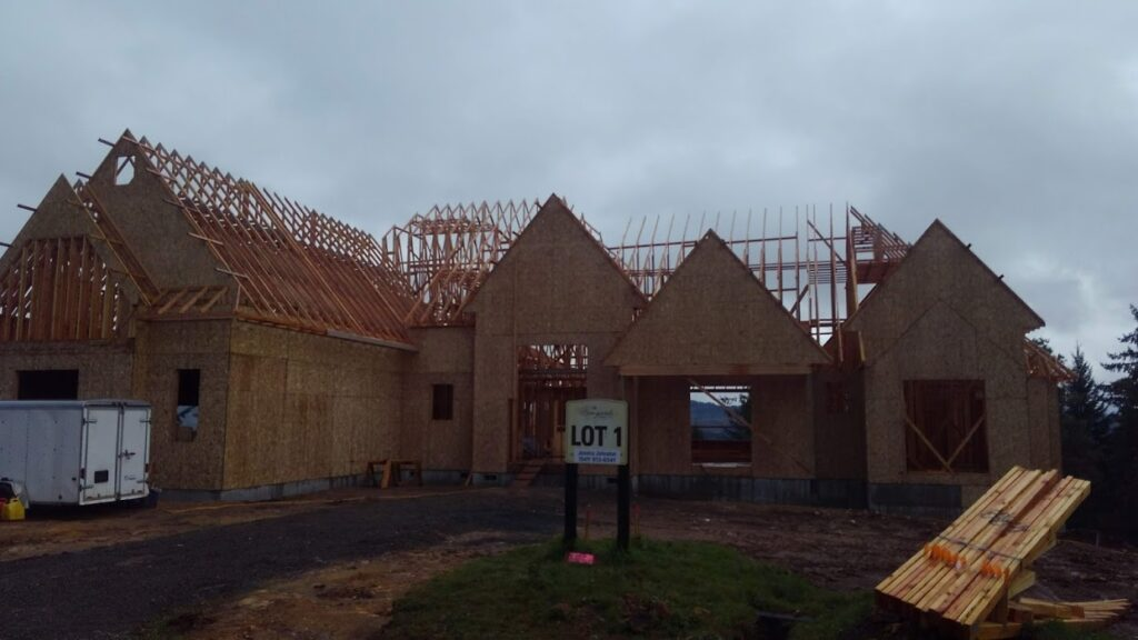 Roof and body framing for a house with some of the initial walls in place