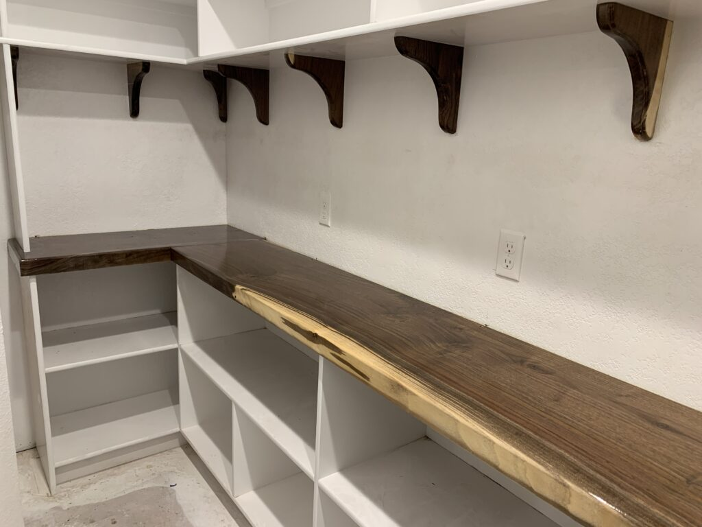 Wood finish on L-shaped closet counter space