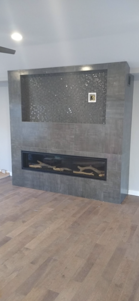 Tile and finishing for a gray modern fireplace